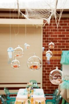 {Under the Sea} Gorgeous Mermaid Birthday Party. Love the hanging fish bowls. by Leticia A.