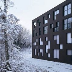 """The modular fenestration of this school building in western Switzerland was inspired by shapes from computer game Tetris. I want my house to have """"modern fenestration"""". Black Architecture, School Architecture, Amazing Architecture, Architecture Details, Interior Architecture, Interior And Exterior, Dezeen Architecture, Building Architecture, Ecole Design"""