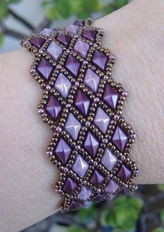 """This beaded pattern tutorial is a DIGITAL FILE, downloadable in PDF file format ONLY. Once payment is confirmed, you will receive an email with a link to download your PDF pattern. If you have any problems downloading your PDF pattern, please contact me. I will be more than happy to send you your pattern via email instead. DIAMOND LATTICE BRACELET ©2017 Deborah Roberti Use size 11 seed beads and two-hole diamond beads (DiamonDuo or GemDuo beads) to create """"columns"""" of diamonds and then fill…"""