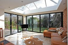 Extension with Bi-folding doors and sky light Kitchen Extension With Bifold Doors, Kitchen Diner Extension, Bungalow Extensions, House Extensions, Lantern Roof Light, Express Bi Folding Doors, Orangery Extension, Open Plan Kitchen Living Room, Kitchen Doors