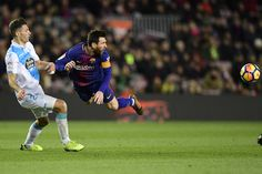 Barcelona's Argentinian forward Lionel Messi (R) and Deportivo La Coruna's Swiss defender Fabian Schaer eye the ball during the Spanish league football match FC Barcelona against RC Deportivo de la Coruna at the Camp Nou stadium in Barcelona on December 17, 2017. / AFP PHOTO / JAVIER SORIANO