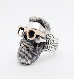 "Sterling silver and 9ct red gold hand engraved ""Hipster skull"" ring.This one of a kind ring is part of a new collection called "" Memento""  from Sirkel Jewellery which is comprised of human and animal skull pieces."