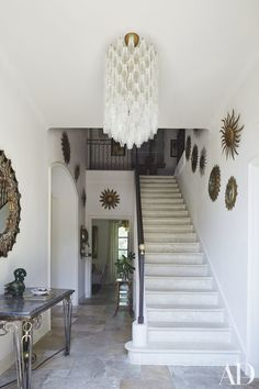 Sunburst mirrors, most sourced from dealers in the region, are arrayed in the entrance hall.