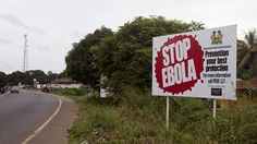 In this photo taken on Tuesday, Oct. 21, 2014, a billboard reading 'Stop Ebola' on the Masiaka Highway, forming part of a trans-West African highway, which links all West African States, on the outskirts of the capital city of Conakry, Guinea. Despite stringent infection-control measures, the risk of Ebola's spread cannot be entirely eliminated, Doctors Without Borders said Friday, Oct. 24, 2014, after one of its doctors caught the dreaded disease while working in Guinea and went to ...