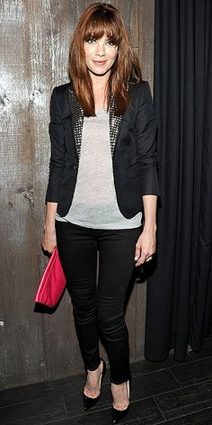 Big bangs, studded blazer bold clutch.  Not bad! Michelle Monaghan