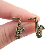 - Description - Details Saxophone shaped stud earrings in brass with rhinestone details in brass! They are small but detailed and are perfect for music lovers! For more music themed jewelry and produc