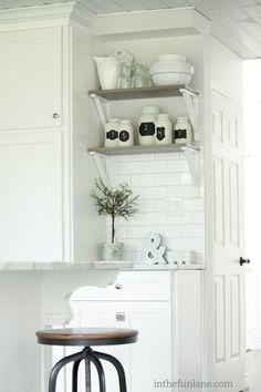 white kitchen. Subway tile. Shelving