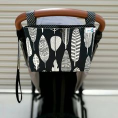 This practical pram caddy easily clips with snap buttons over your pram or stroller handle bars. Perfect for storing your keys, phone and small purse! Measurements: (you can choose from small or medium size) Small: 14cm high x 22cm wide x 6cm deep Medium: 19cm high x 32cm wide x 8cm