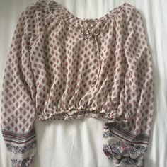 Pacsun long sleeved shirt It's white with a detailed pattern and is cropped with long sleeves PacSun Tops Crop Tops