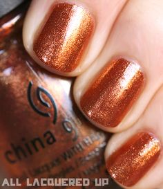 "China Glaze ""Harvest Moon (District 9)"".  Hunger Games collection, and currently on my fingernails!  it really looks this good. I love hunger games."