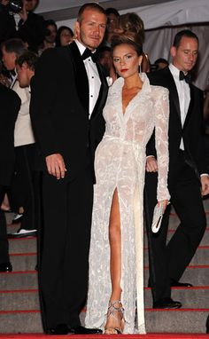 Victoria Beckham Style Evolution: Stepping out for the Costume Institute Gala in 2008, both the Beckhams go elegant and this time mix and match black and white.