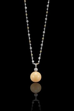 An extremely rare and unique Melo Pearl and Diamond Pendant/Necklace by Tiffany & Co.