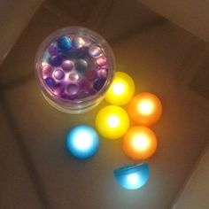 Water beads sealed in a clear container illuminated by lights beside it. @playing_in_k