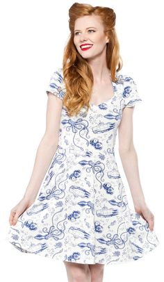 STEADY RETRO DIVER DRESS IVORY - This nautical themed dress will have you diving head first in style! The soft comfortable knitted ivory fabric is printed with features a diamond shaped neckline and cap sleeves and flowy skirt. The perfect dress to wear while battling the Kraken twenty thousand leagues under the sea!