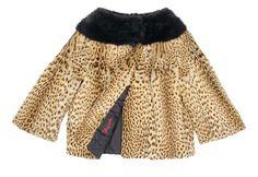 Schiaparelli Geoffrey's Cat Fur Jacket French, circa 1948 Short flared design with mink yoke, wide raglan bracelet length sleeve, lined in black silk jacquard with Schiaparelli signature, size 8, labeled: Schiaparelli/Paris. Excellent condition