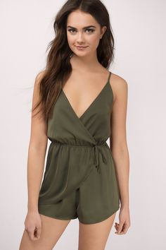 Casual meets sexy with the Keeley Tied Romper. Wrap front romper with a tie, featuring an open back and low v-neck. Wear with sandals and your fav sun