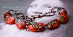 Handcrafted glass beads by Deborah JLambson ~:Saree:~       ReD! Leaning to the oranges..a ripening tomato red.     I'm a lover of organ...