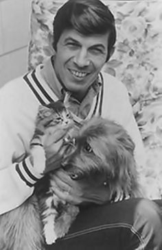 Leonard and a cat and a dog