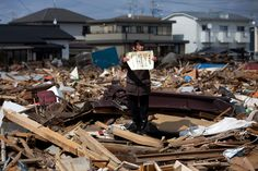 1st Prize People in the News Stories: Chieko Matsukawa shows her daughter's graduation certificate, after she found it in the debris in Higashimatsushima City, Miyagi prefecture, Japan, April 3, 2011. (Yasuyoshi Chiba/AFP) #