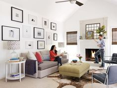 Huge open white space, with high ceilings, neutral colors, and an amazing gallery wall #hgtvmagazine http://www.hgtv.com/decorating-basics/our-first-grown-up-house/pictures/page-4.html?soc=pinterest