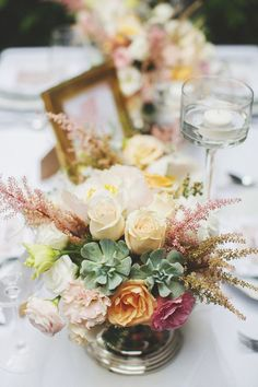 Flower centerpiece with succulents | One Shoot, Two Looks: Wilderness and Countryside Charm Inspiration {Facebook and Instagram: The Wedding Scoop}