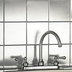 Metal peel and stick tile.  Kitchen backsplash behind stove?