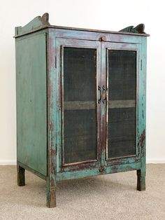 wide x high x deep. A wonderful old vintage cabinet made from teak and full of character. Has wire mesh on the doors. Would make a great drinks cabinet. Approx years old. Free delivery in Rotorua. Vintage Cabinet, Drinks Cabinet, Cabinet Making, Vanity Ideas, Wire Mesh, Sideboard, Free Delivery, Teak, Hand Carved