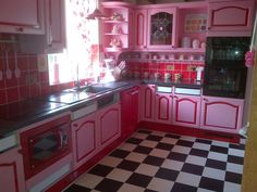 Shabby ♥  Pink Kitchen with Checkered Floors--I wonder if Seth would let me do this... :)