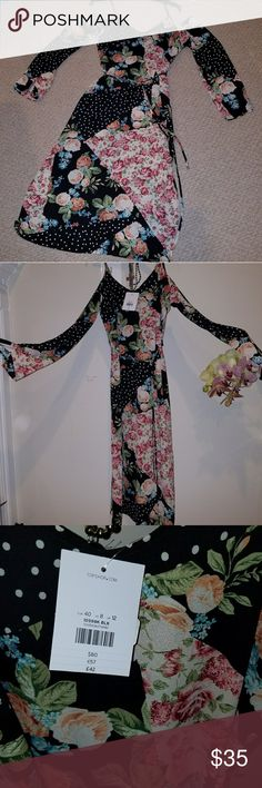 Floral Cold Shoulder dress Perfect condition,  very light , unique piece, the dress split from knee down. Topshop Dresses Long Sleeve