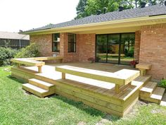 Finished Flip Photos: The Backyard by It's Great To Be Home, via Flickr  - love this deck and built in seating