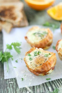 {Bacon & Parmesan Egg Cups}... Spray muffin pan... Line with precooked bacon... Put uncooked egg inside bacon... Bake 300/20-25 mins... Immediately top with parmesean cheese and parsley