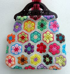 gorgeous! I've got some handles like this... #crochet #bag #flowers