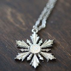 Silver Glitter Snowflake Necklace inspired by OUAT. ✨Ships from California, USA✨ *As with all our jewelry, this necklace is not waterproof and should be taken off before bathing and swimming. **All of