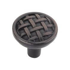 This brushed oil rubbed bronze finish round cabinet knob with braided design is a part of the Ashton Series from Jeffrey Alexander. A perfect blend of craftmanship in traditional and contemporary design to complement any decor.