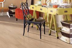 Prequel luxury vinyl tile flooring in Noce color. Prequel comes in and construction.
