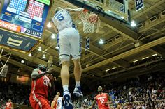 Mason Plumlee, who set an all-record for dunks by a Duke player, receives a lob from Quinn Cook. Sweet