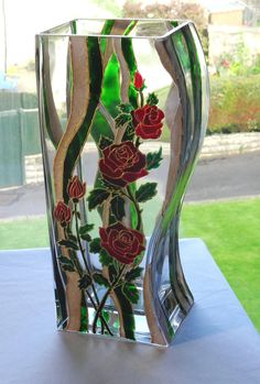 Glass vase hand painted roses in luxurious red green and gold.