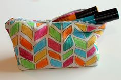 As an artist, I love designing different things and for today's post I'm going to show you how I designed my own fabric for this zippered pouch using the Paper Crafter Crayons. 1. Draw your designs directly onto your fabric with the Paper Crafter Crayons. You can use a stencil...