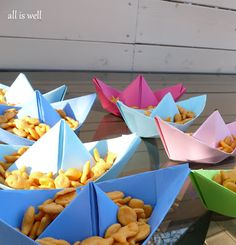 I love these origami boats. Could be food containers for small lollies etc in red or white with food sign stapled/glued to mast