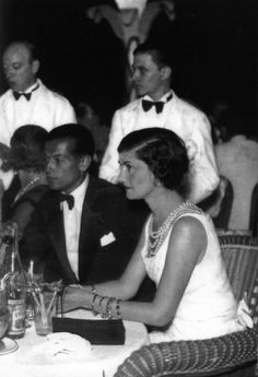 Coco's First High Jewelry Collection Reimagined by Chanel 80 Years Later - Gabrielle Chanel and her friend Serge Lifar, choreographer and dancer, at a 1933 Monte-Carlo gala - Marca Chanel, Chanel Nº 5, Perfume Chanel, Mode Chanel, Chanel Brand, Chanel Couture, Chanel Fashion, Vintage Chanel, Coco Chanel 1920s