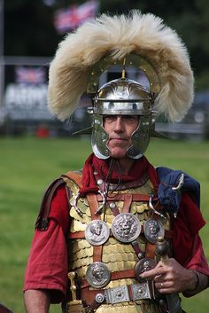 A centurion's set of phalerae and torques adorn his chest and celebrate his feats of bravery in battle.