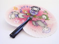 Loved these plastic foldable fans. They used to sell them at our zoo with different animals.