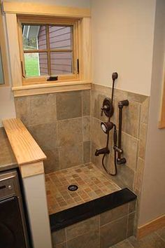 """This is genius. The design could use some work, but outstanding idea for a laundry or mud room. """"Built-In Dog Shower = Happier Owner and Dog. Read this How-to on how to build a custom dog shower using an American Standard Portsmouth shower system. Corner Deco, Balinese Decor, Dog Wash, Dog Rooms, Dog Shower, Shower Systems, New Home Designs, Küchen Design, Interior Design"""
