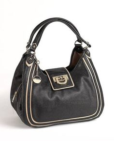 """DKNY Black Leather Hobo Bag Contrasting trim and goldtone hardware perfectly complement the soft, pebbled leather of this dkny hobo bag. Open the snap-strap of the bag to reveal a zippered center pouch with a snap pouch on either side, allowing for ample storage and easy organization. Dual handles snap-flap closure interior zip pocket and three slide pockets approximate measurements: 13 1/2"""" w x 12"""" h x 6 1/2"""" d handle drop: 8"""" imported."""