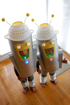 """I wanted the robots to be goofy, so they needed to have big mouths, wonky antennae, and lots of blinking lights. Soda bottle jet packs on the back are good for getting to the candy faster; and the ""spontaneously-combustible"" hazard warnings on the back are a public service … because; while they might appear harmless and goofy, you still never know when these things might go 'off.'""    The robot helmets are plastic colanders, which glow at night from the lights mounted inside.    The robot…"