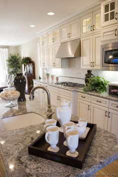 Antique White Kitchen with Blue Paradise (Azul Aran) Granite