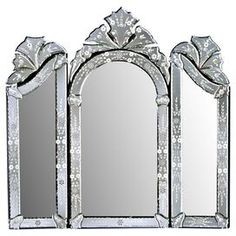 """Cut, beveled, and etched by hand, this Venetian-style wall mirror brings rich detail and beautiful craftsmanship to your walls.  Product: Wall mirrorConstruction Material: Mirrored glassColor: SilverFeatures:  Uses old techniques copied from Venice, ItalyBeauty and original charm of 16th and 17th centuryMirror is hand etched, cut, beveled, and polished  Each hand-cut mirror piece is assembled separately and attached to the wood backing with a tiny screw and rosette cover Dimensions: 29"""" H x…"""