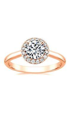 intricate halo of pavé-set diamonds