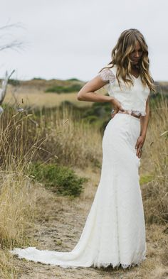 "Two piece beach wedding dress style, the ""Caterina"" puts a modern twist on the typical wedding dress. Fully lined with ivory satin and covered in an"