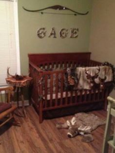 I'm in love, cute baby hunting room. Camouflage painted letters from Michael's Craft store. Plush whitetail buck rug can be purchased at: www.logfurnitureplace.com/plush-white-tail-deer-rugs.html